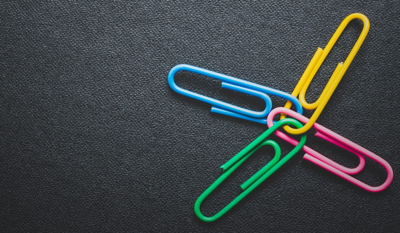paper clips on black background, teamwork and success concept.